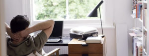 man-reclining-in-home-office